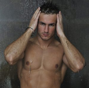 good looking man under man shower